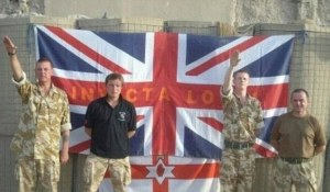 Two British soldiers salute Nazi-style